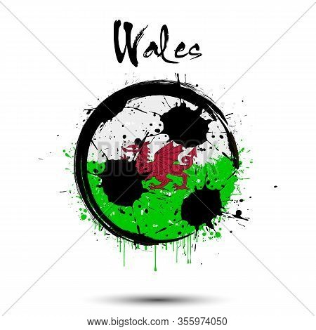 Abstract Soccer Ball Painted In The Colors Of The Wales Flag. Flag Of Wales In The Form Of A Soccer