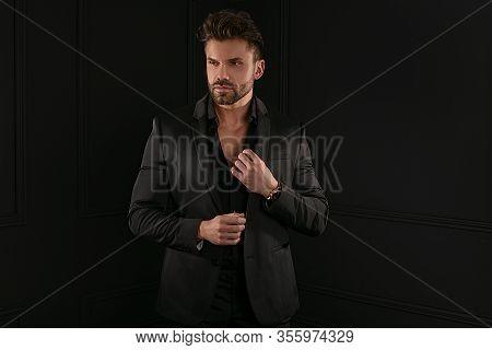 Man In Elegant Black Suit Posing
