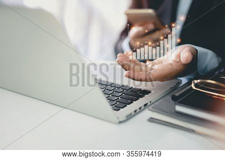 Business Man In Black Suit Sitting And Working On Computer And Mobile Phone. Man Hands Showing Busin