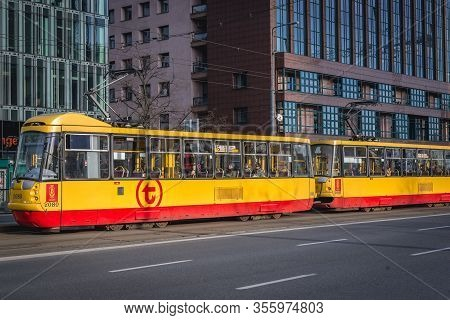 Warsaw, Poland - March 17, 2020: Tram with only few people during rush hours in Warsaw after Polish government has declared a state of epidemic threat to limit spread of Coronavirus