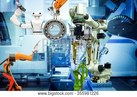 Industrial Robotics Welding, Robotics Gripping And Smart Robot Working With Auto Part Of Vehicle On