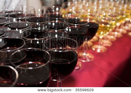 A bunch of glasses with wine in restaurant