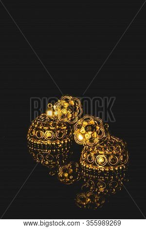 Earring Gold Jewelry Traditional With Stones And Two Golden Earrings With Reflection . Pair Of Golde