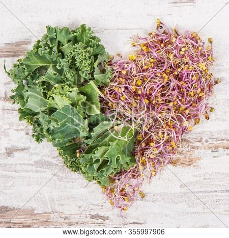 Fresh Kale Sprouts With Green Leaves Of Vegetable In Shape Of Heart. Food Containing Natural Healthy