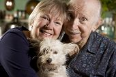Close Up Portrait of Senior Couple with Dog poster