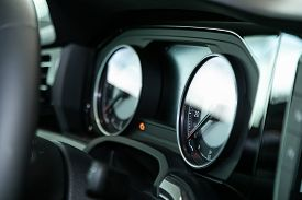 Close Up Instrument Automobile Panel With Odometer, Speedometer, Tachometer, Fuel Level, Soft Focus