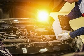 Male Mechanic Changing Car Battery, Engineer Is Replacing Car Battery Because Car Battery Is Deplete