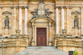 Grand Doors Of Cathedral In Germany. Entrance In High Arch With A Lot Of Sculpture In It And Statues
