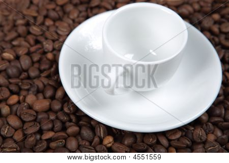 The White Coffee Cup On Coffee Beans