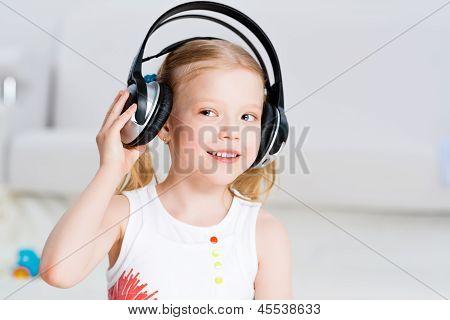 Pretty girl listening to music on headphones
