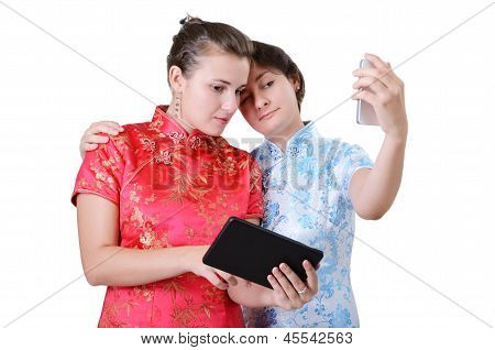 Young Women With Mobile Devices