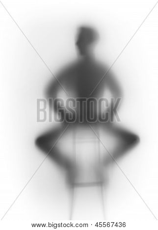 Male human body sits on a chair, silhouette