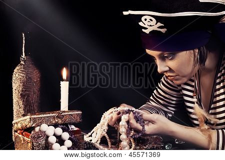 Woman the pirate  looking at jewelry