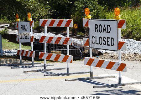 Road Closed Barricades At A Railroad Crossing
