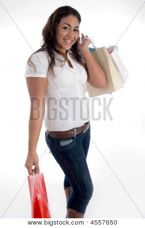 Happy Girl Posing With Shopping Bags