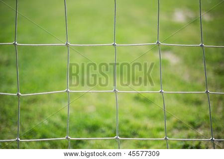 Football net and green grass background. Sun light poster