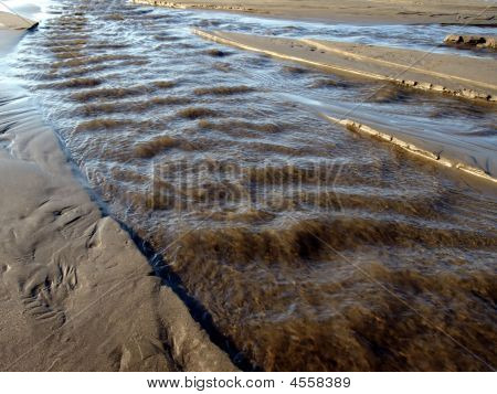 Rushing Riptide On The Beach