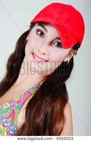 Attractive Teen Girl In Red Cap