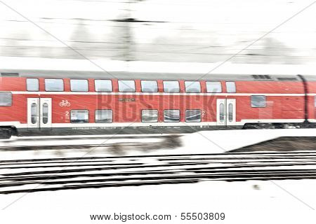 Train In Wintertime On Track In  Snow Flurry