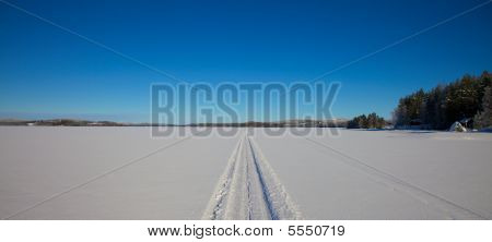 Snowmobile Track In White Snowlandscape