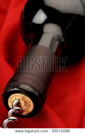 Close up image of red wine cork puling out