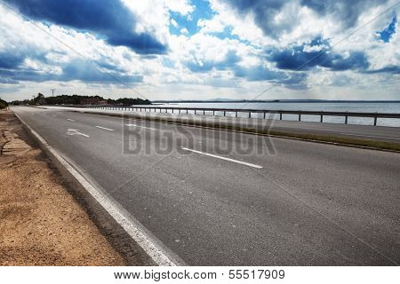 road by the sea on a sunny day