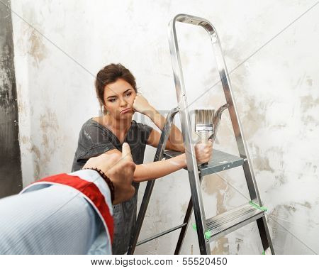 Man's hand pouting on a disgruntled woman worker