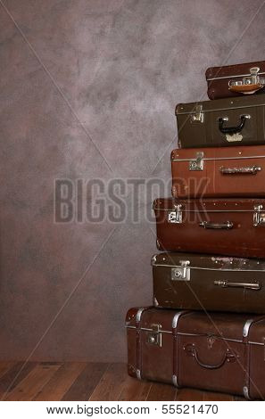The old retro suitcases at a wall