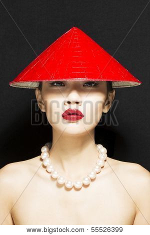 Asian Girl in Conical Hat