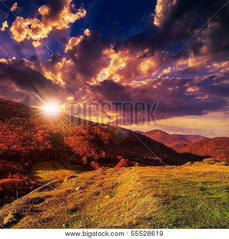 Autumn Hillside With Red And Yellow Forest At Sunset