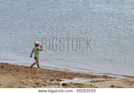 Boy near the water.