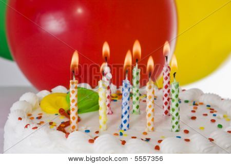 Close-up Of A Birthday Cake With The Candles Lit