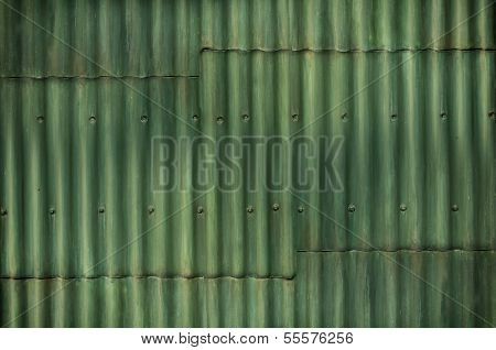 Multi tone Green Corrugated Wall With Seams And Bolts Add Interest To The Background