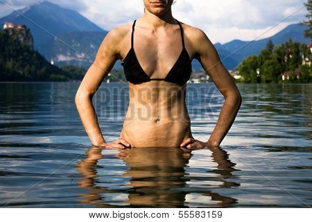 Woman Relaxing In Lake With Mountain And Castle In Background, Bled Slovenia