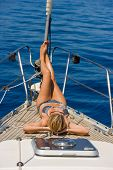 Young sexy woman on her private yacht poster