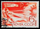 USSR - CIRCA 1969: A stamp printed in USSR, parachuting, athlete puts the parachute, circa 1969 poster