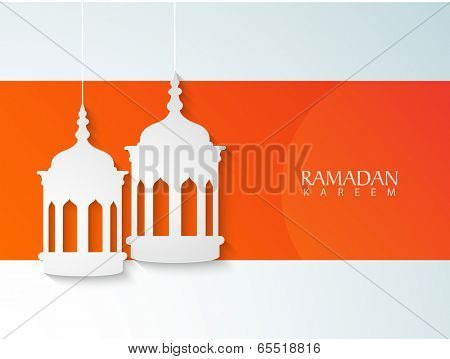 Hanging intricate arabic lamps on blue and orange background for holy month of muslim community Ramadan Kareem.