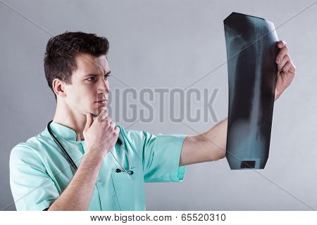 Doctor Analysing A Skiagraph