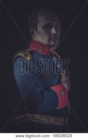 Retro, old soldier style jacket with blue and gold epaulettes, Spanish army