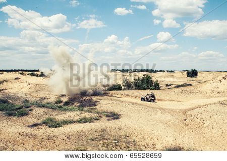 Large explosion near the car with soldiers in the desert poster