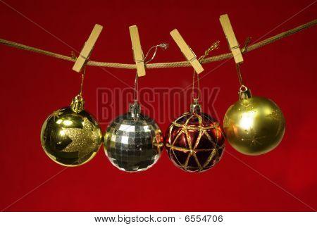 Christmas ball on clothespins
