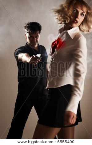 Man. Gun. Woman