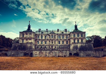 Old stylized Pidhirtsi Castle village Podgortsy Renaissance Palace front view Lviv region Ukraine poster