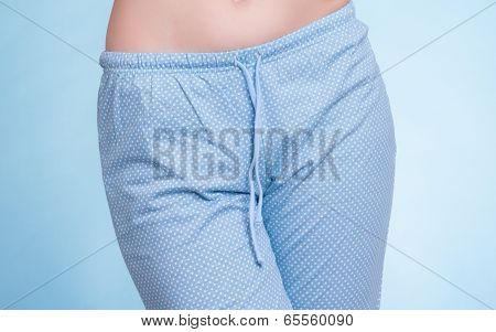 Female Legs Wearing Blue Pajama Pants