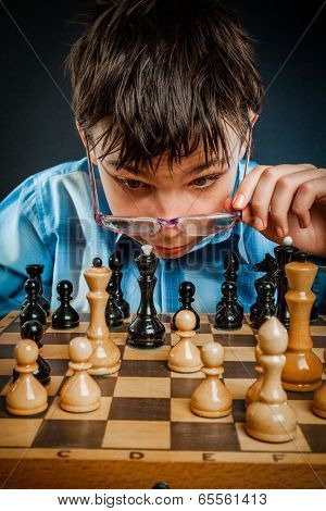 Wunderkind play chess. Funny Nerd boy.