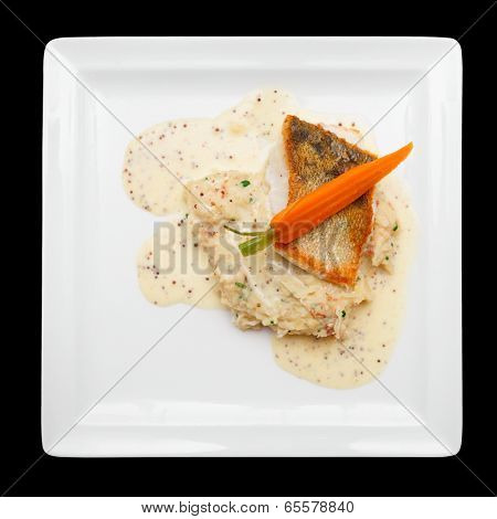 Fried walleye with sauercraut and potato isolated over black