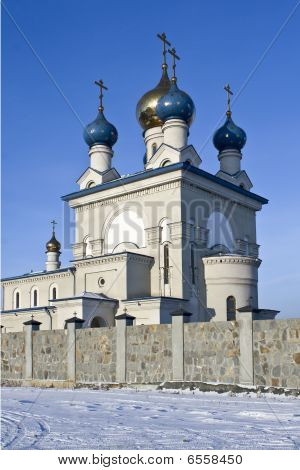 """Cathedral """"Satisfy Mine Grieves"""" it is located in the city of Chelyabinsk, Russia, on the bank of lake Smolino. It is consecrated in 2000. The patriarch of Russia Alexey II. poster"""