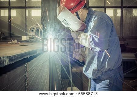 Welding work issued strong dazzling rays of light poster