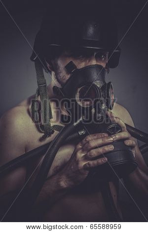 Vintage nuclear and toxicological disaster ,man with gas mask