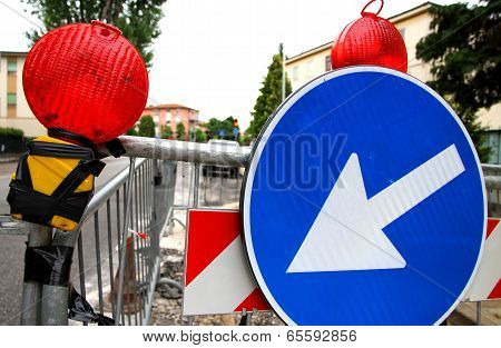 red signal lamps and a huge road sign to delimit the roadworks in the city poster